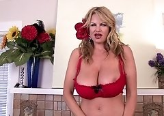 Kelly Madison uses a red toy to make her pussy dripping wet
