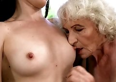Horny grandma and sexy young chick spend a hot lesbian moment together