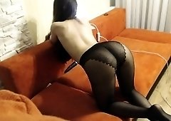 Pantyhosed brunette camgirl makes herself cum with sex toys