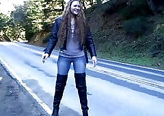 The prostitute walks in thigh boots in a puddle!