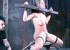 On a bondage device she gets toyed by master BDSM