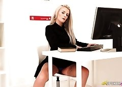 Serious looking office nympho Dolly P flashes her upskirt in the office