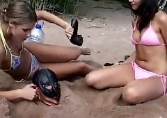 Buried in the sand slave spitted & cock humiliated