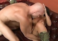 Big tits brunette with tats and boots gets fucked on a leather couch