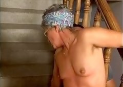 Mature white lady riding on a dick of a young man on the stairs