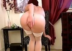 Slender tanned whore in white stockings Sofia Matthews pets her twat