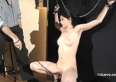 Master uses nipple clamps, floggers and whips to dominate hi