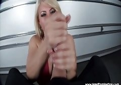 MILF worships a large curved cock during a pov handjob