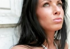 Black haired babe Tereza masturbates outdoors