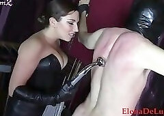 Black Leather Domme Flogs Restrained Naked male slave