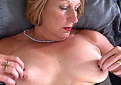 Buxom mature blonde granny Rosemary masturbates with toys