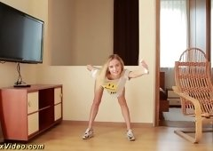 Svelte auburn fresh girl does some morning stretching and flashes tits