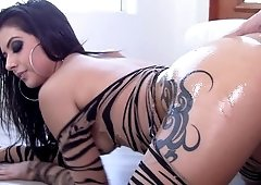 Luscious dark haired woman gets oiled up and fucked by a stud