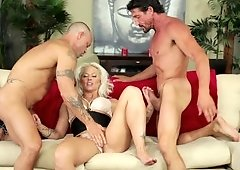 A milf with a nice rack is getting her cunt rammed in a threesome